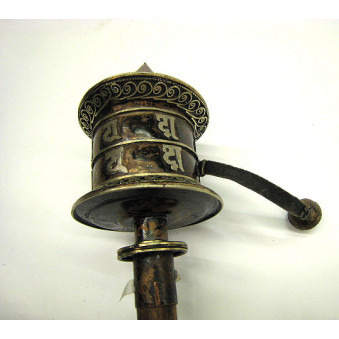 Prayer wheel Tibet. Mani script