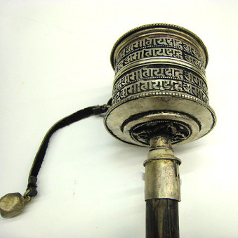 Prayer wheel Tibet. Mani script WM